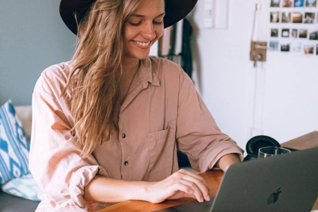 lady smiling long blonde hair typing on computer blog growth formula it started with a blog